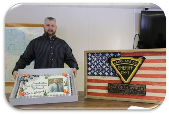 Retired Investigator with cake and plaque