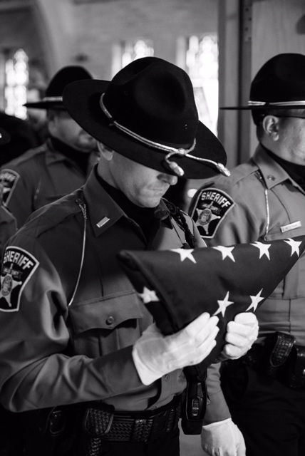 Deputies Funeral Duty holding folded flag