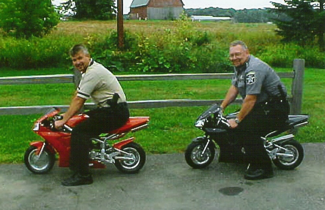 Officers on mini motorcyles