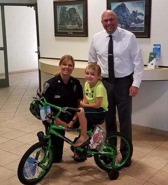 Boy and bike with sheriff westen