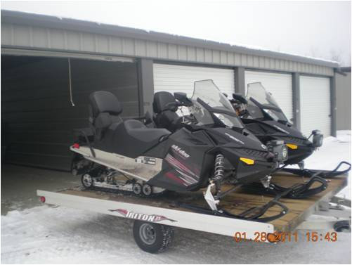 Two snowmobiles on trailer