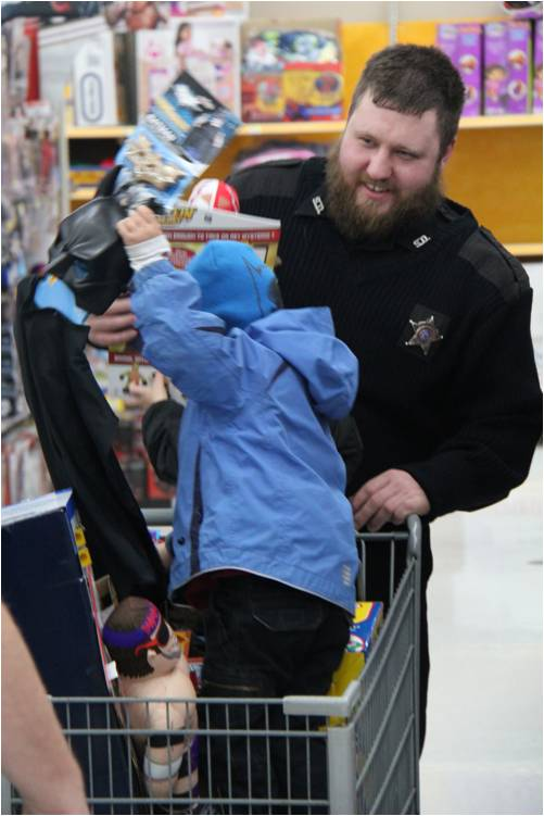 Officer with child in shopping cart